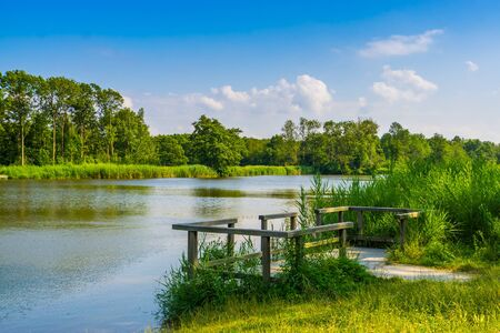 Water lake with jetty and beautiful nature scenery, the melanen, Halsteren, Bergen op zoom, The Netherlands