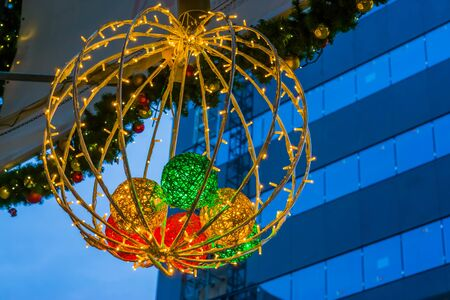 Beautiful lighted christmas decoration hanging in the city, Seasonal Tradition Stockfoto