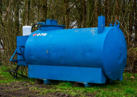 Hazardous liquid tank, Barrel with warning stickers, Portable Silo