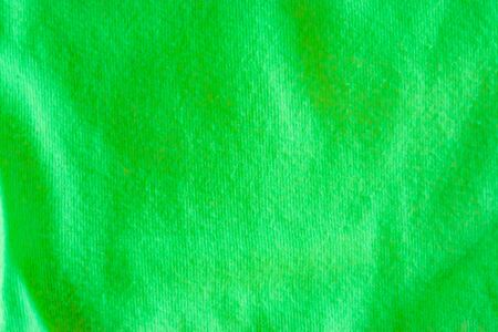Modern apple green cotton fabric in macro closeup, popular material for clothes