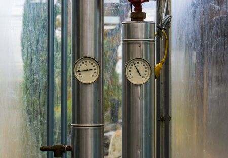 two pipes with pressure heat meters, modern industrial equipment