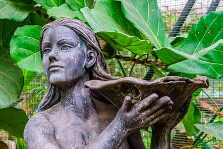 beautiful closeup of the face of a female statue holding a bowl, Garden decorations and architecture