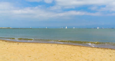 the beautiful beach of Breskens with boats sailing on the ocean, Zeeland, The Netherlands 版權商用圖片