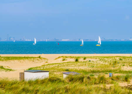 the beautiful dunes of Breskens with boats sailing on the sea, Dutch nature landscape, Zeeland, The Netherlands