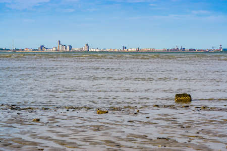 the Mudflats of Breskens beach with view on vlissingen city, Zeeland, The Netherlands