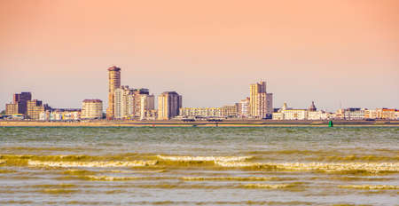 beautiful view on Vlissingen city from Breskens beach, Sunset and waves in the sea, Zeeland, The Netherlands Reklamní fotografie - 155457647