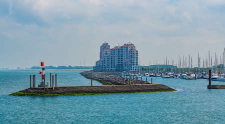 The harbor of Breskens with jetty, boats and big building, Zeeland, The Netherlands 版權商用圖片