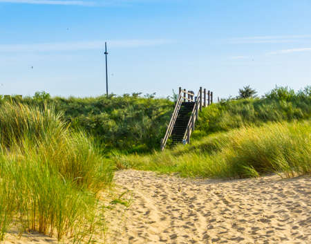 Walking path with staircase on Breskens beach, Zeeland, The Netherlands