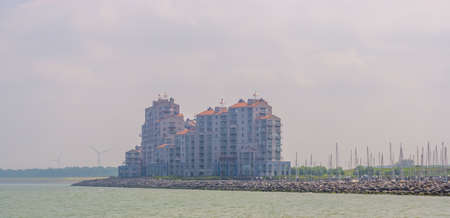 big apartments complex building in the harbor of Breskens, Zeeland, The Netherlands Imagens