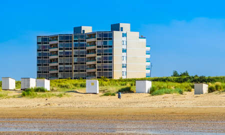 beautiful beach of Breskens with cottages and apartments building in the background, Dutch Architecture, Zeeland, The Netherlands