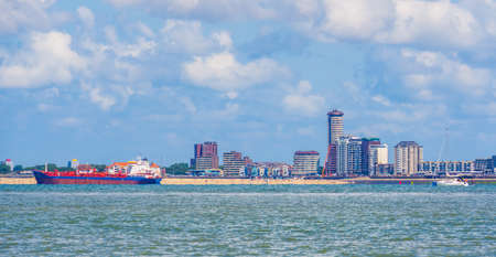 city scape of vlissingen with a boat sailing by, Breskens, Zeeland, The Netherlands 版權商用圖片