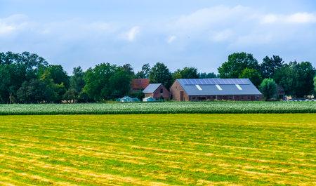 typical dutch farm building in the fields, country landscape, Waterlandkerkje, Zeeland, The Netherlands