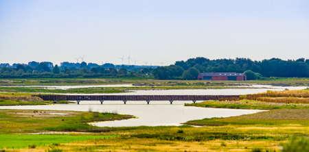 the beautiful water lake with bridge in breskens, Waterdunen reserve, Zeeland, the Netherlands
