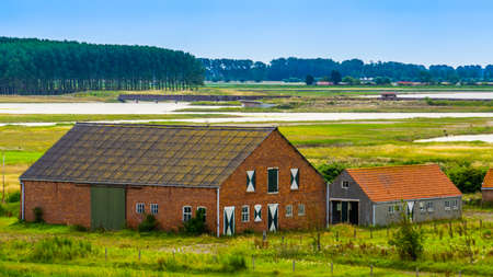 Farm building at the water lake of Breskens, Zeeland, The Netherlands