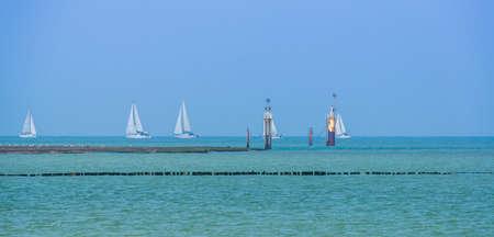 Sailboats sailing near the coast of Breskens, Zeeland, The Netherlands