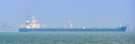 massive freight ship sailing near Berskens and Vlissingen, Zeeland, The Netherlands Zdjęcie Seryjne