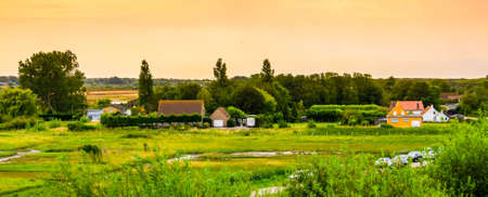 green country side scenery with houses during sunset, Breskens, Zeeland, The Netherlands