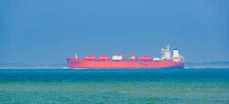 Red tanker ship transporting cargo near breskens and vlissingen, Zeeland, The Netherlands