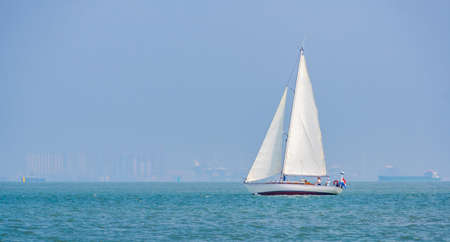 Sailboat sailing on the ocean between Breskens and Vlissingen, recreational summer sports, Zeeland, The Netherlands