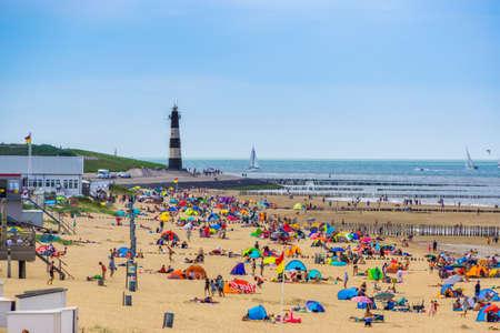 crowded beach in Breskens during summer season, Breskens, Zeeland, The Netherlands, 20 July, 2020 Publikacyjne