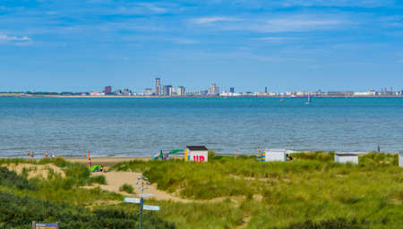 The beach of Breskens with dunes and view on Vlissingen, 20 July, 2020, Breskens, Zeeland, The Netherlands