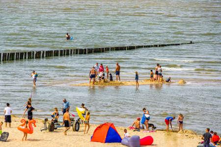 Tourists recreating on the beach of Breskens during summer season, Breskens, Zeeland, The netherlands, 20 July, 2020