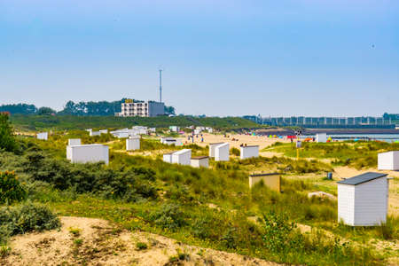 View from the dunes on the beach cottages and touristic beach, Breskens, Zeeland, The Netherlands, 24 June, 2020