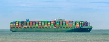 Tokyo Triumph Sailing on the ocean of Vlissingen, huge container shipment, Breskens, Zeeland, The netherlands, 20 July, 2020 Publikacyjne