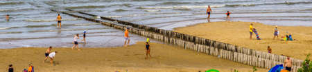 tourists recreating and playing games at the beach of Breskens during summer season, Breskens, Zeeland, The Netherlands, 20 July, 2020