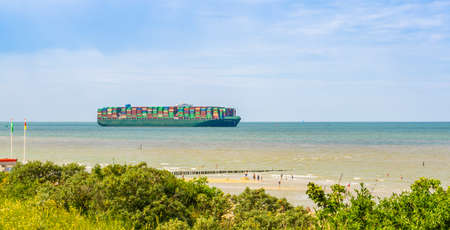 Tokyo triumph transporting containers, beach of Breskens, Zeeland, The Netherlands, 20 July, 2020