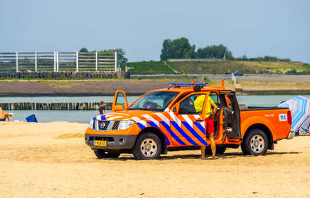 life guard at his truck on breskens beach, safety and surveillance, Breskens, Zeeland, The Netherlands, 20 July, 2020