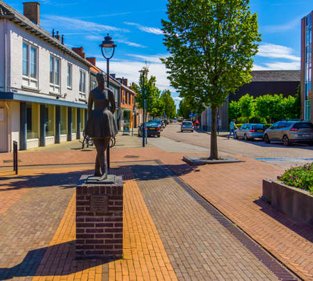 The dancing girl monument with street view, popular city sculpture, Raadhuisplein, Oostburg, Zeeland, The netherlands, 24 July, 2020