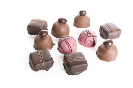 Ten gourmet chocolates isolated on white. Stock Photo - 7471491