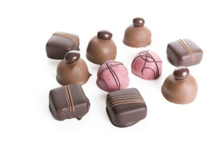 Ten gourmet chocolates isolated on white. Stock Photo - 7471491