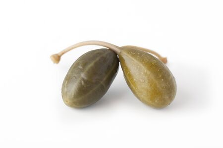 Two capers isolated on a white background.