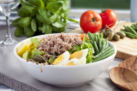 Salad Nicoise with ingredients in background.
