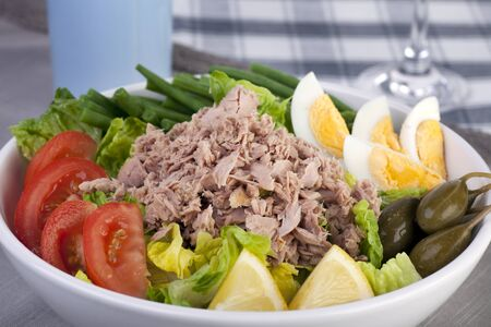 Close up of bowl of salad Nicoise . Stock Photo