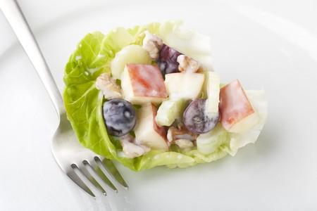 Lettuce leaf filled with Waldorf salad.