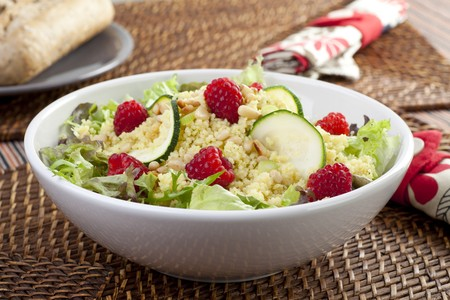 Couscous salad with zucchini and raspberries and pine nuts.