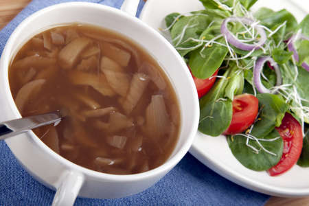 Onion soup with spoon and side salad. Stock Photo - 7747477