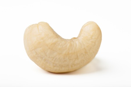 Single cashew nut isolated on white background.