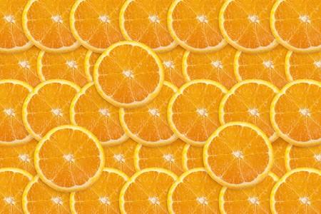 Vibrant orange slices filling entire frame.  Great food background.