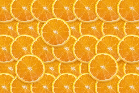 Vibrant orange slices filling entire frame.  Great food background. photo