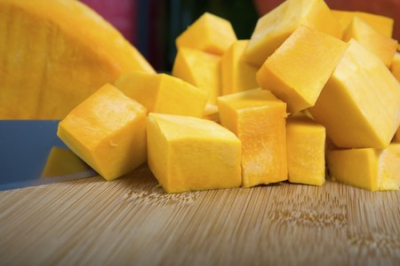 cubed: Cubed pumpkin on cutting board with knife