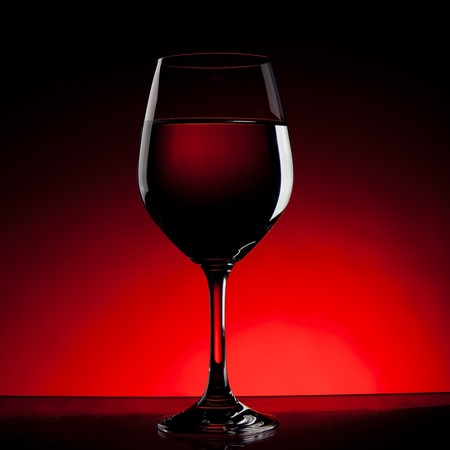 Wine glass outlines with red background.