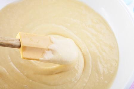 stirred: Batter being stirred by spatula.