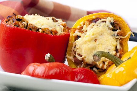 Fresh bell peppers stuffed with wild rice and topped with cheese. Stock Photo