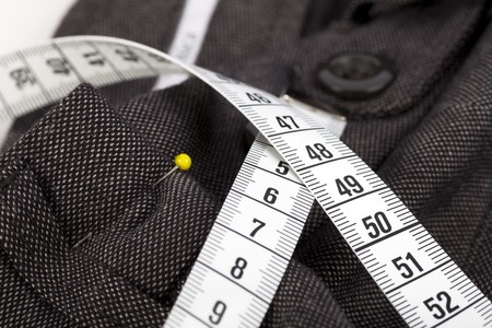 Measuring tape and trousers about to be altered.
