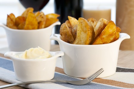Spanish tapas, patatas bravas with garlic mayonnaise dipping sauce.