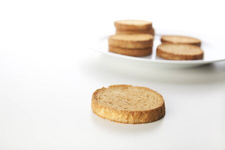 Crispy round Dutch breakfast biscuits isolated on white background.